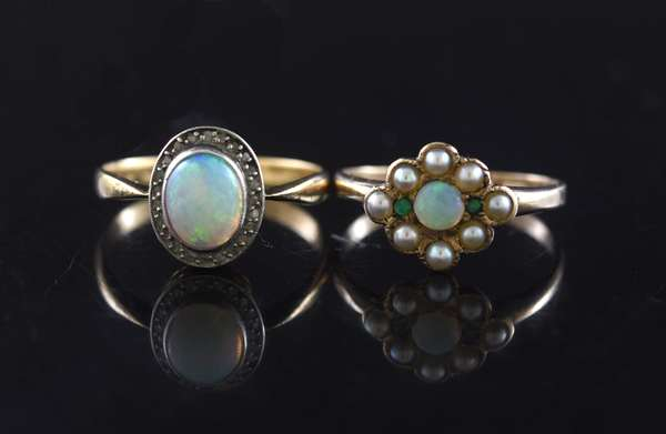 Two opal rings: 14kt yellow gold, opal, pearl and emerald, sz. 6, opal cabochon w/ diamonds, sz. 7, 3.8 grams.
