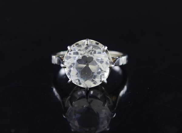 18kt white gold (tested) 8 prong solitaire mounting (currently set w/ 11mm glass), sz 6, 5.0 grams.
