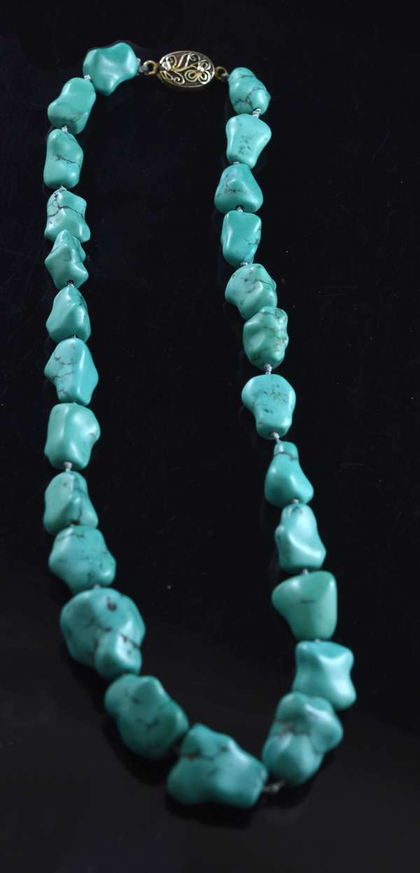 Fingerbone turquoise bead necklace, 13.5-19.5 mm, silver clasp, 18 1/2 inches long.