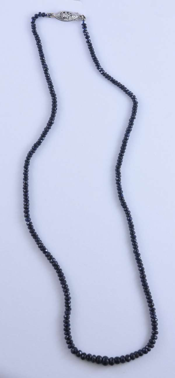 Navy blue sapphire faceted bead necklace, approx. .50 ct. tw., 14kt white gold filigree pearl clasp, 18 inches long.