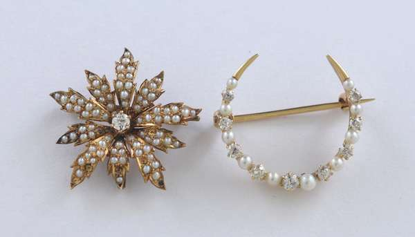 Two 14kt yellow gold pins, crescent with pearl and diamond, approx. .25 ct. tw. Old European cut diamonds and seed pearl flower pin with approx. .10 ct. Old European cut diamond, 1 in. diameter, 6.4 grams.