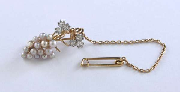 14kt yellow gold pearl grapes cluster pin set with approx. .35 ct. tw. of Old European cut diamond leaves, 4.7 grams.