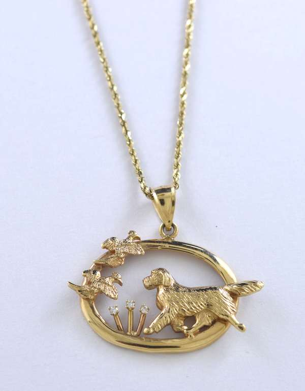 14kt yellow gold Irish setter chasing pheasant pendant accents with 3 small diamonds, 1 1/4 in., 16 in. long, 11.1 grams.
