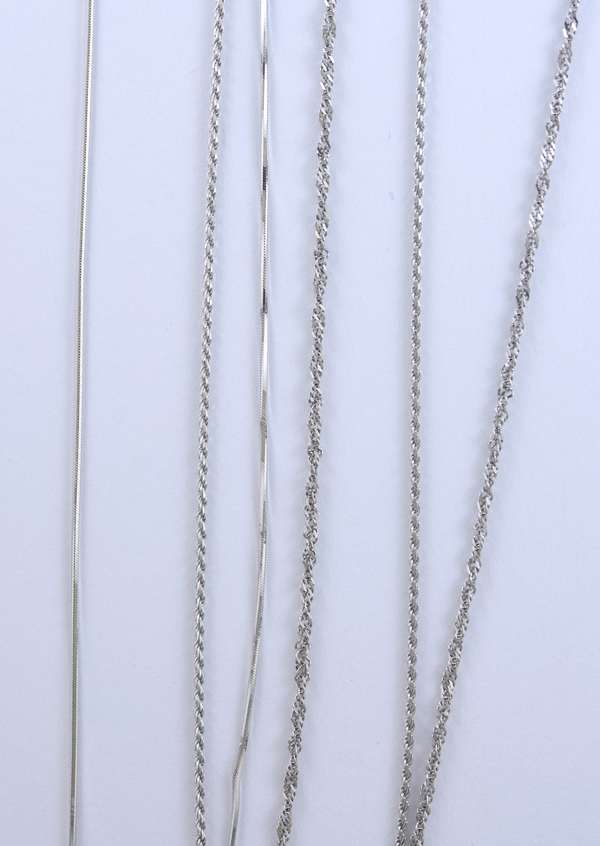Three 14kt white gold chains, 20 in. rope, 18 in. wheat and diamond cut square snake, 11.7 grams.