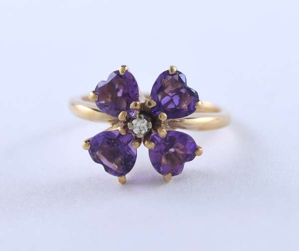 Heart shape amethyst 14kt yellow gold ring approx. 3.0 ct. tw. accented by approx. .01 ct. round brilliant cut diamond, 4.7 grams.