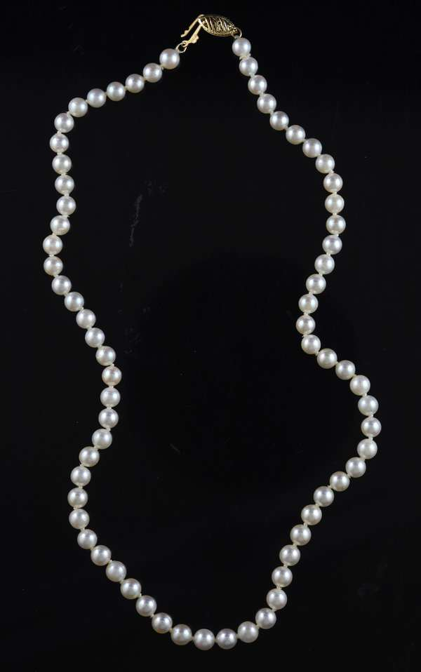 Cultured saltwater pearls, 5 mm white with 14kt yellow gold clasp, 16 in. long.
