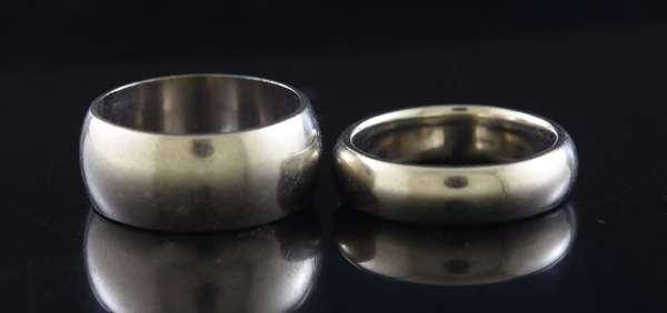 Two 14kt white gold wedding bands: 8.5 mm half round, sz 6 1/2, 5 mm half round comfort fit, sz 6 1/4, 15 grams.