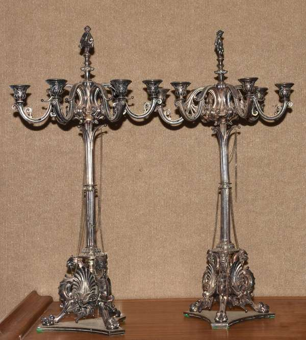 """Pair of silvered candelabras with figural finials, signed Ovington, 28""""H."""