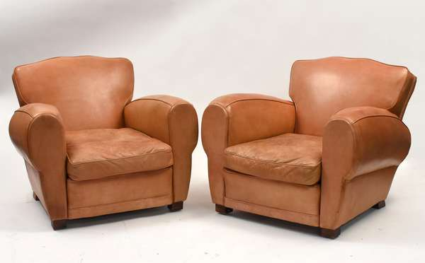 Pair of small size leather club chairs