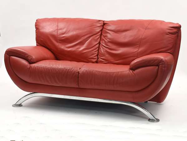 "Red leather and chrome modernist settee, 69""L. x 36""H."