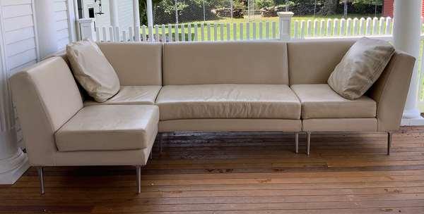 "Italian cream leather and chrome two-part sofa, 66""L."