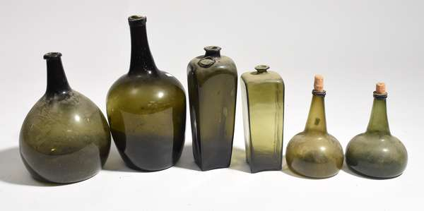"""Six early green glass bottles, onion and others 8-14""""H."""