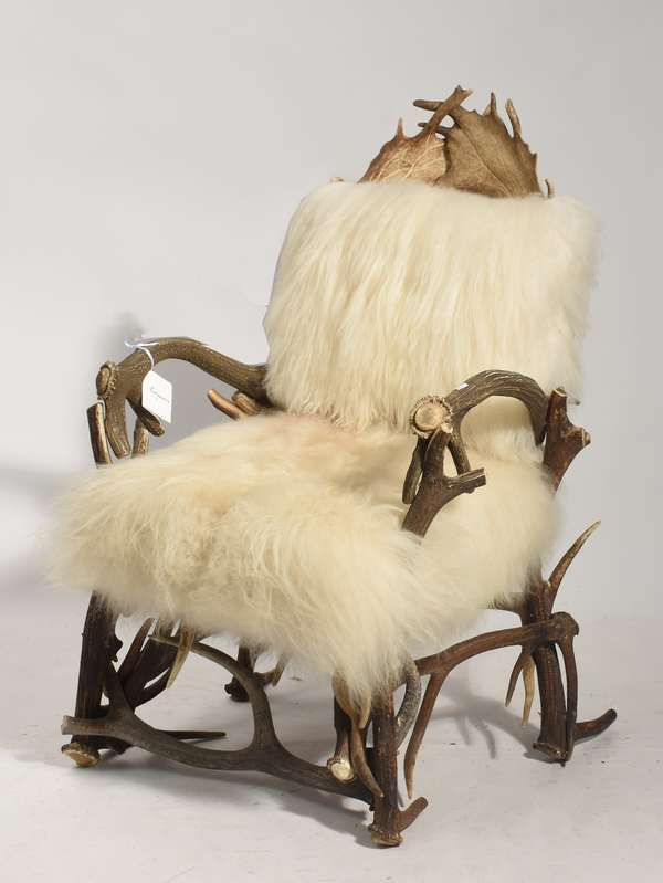 """An exceptional antler armchair, with Mongolian white lamb fur covered seats, 27""""W. x 45""""H., retail cost $4200"""