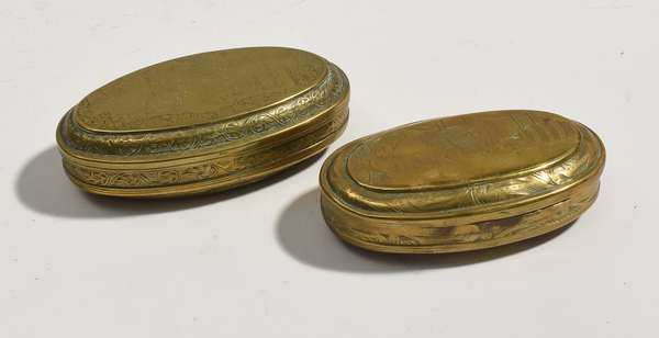 """Two 18th C. oval brass tobacco boxes, both 4.75""""L."""