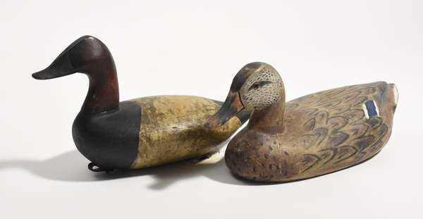 """Two painted wooden duck decoys, one with label, Fred Hildebrand, Tuckahoe, NJ, 16""""L., and female mallard by D. Hodgeman, 16.5""""L."""