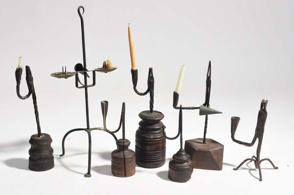 """Seven early iron rush lighting devices, 9"""" - 20""""H."""