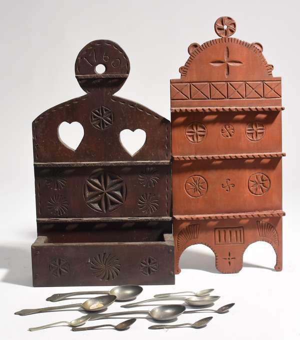 """Two carved hanging spoon racks with pewter spoons, one inscribed 1760, MH, 11.5"""" x 20"""", with other, 9.5"""" x 22"""""""