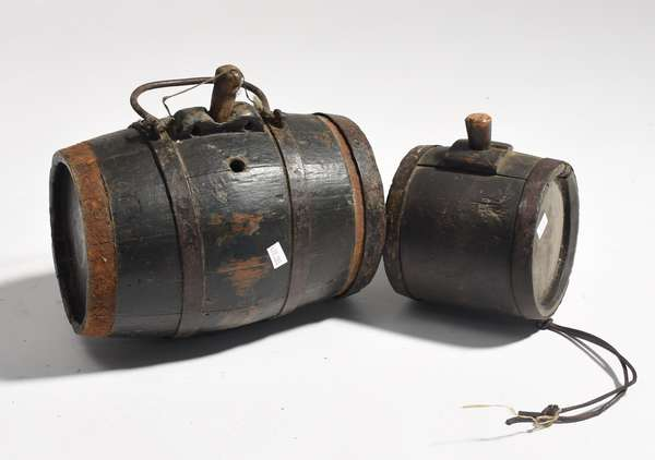 """Two early canteen kegs, one stamped P. P. & H., 5""""L., 10""""L."""
