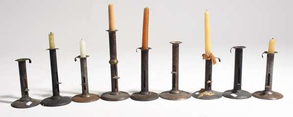 "Nine antique hog scraper candlesticks, 6.5"" - 9""H."