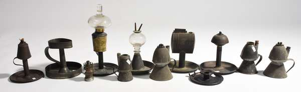 Eleven antique oil burning tin lamps