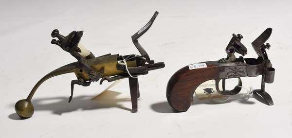 "Two early pistol grip flint lock tinder lighters, 5"", 7.5""L."