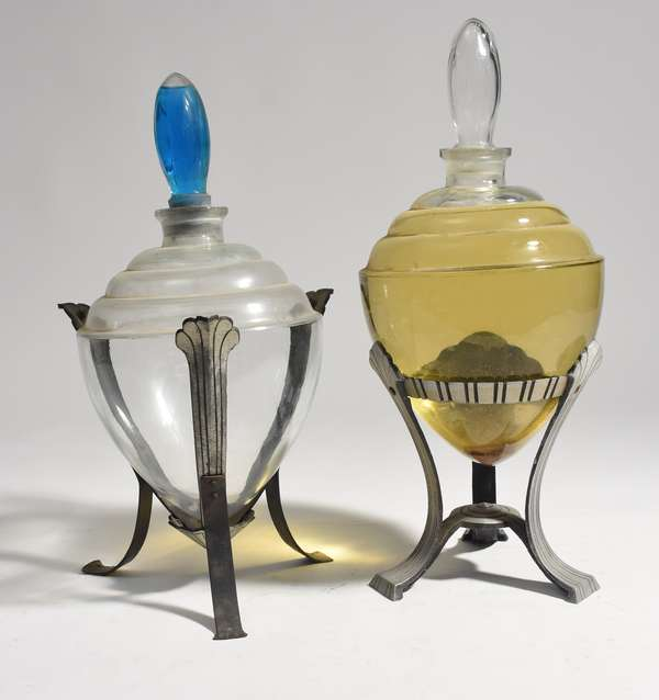 """Two vintage glass apothecary show globes on tri-footed stands, 22""""H. and 24""""H."""