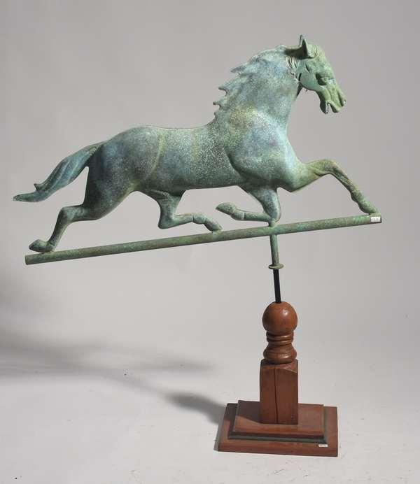 "20th C. running horse weathervane on custom wooden base, 32""L. x 20""H."
