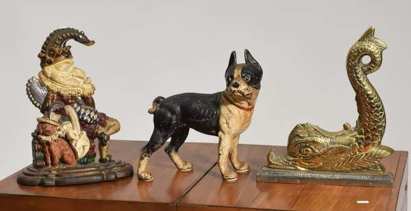 Three door stops cast iron inc Punch and Judy, Boston Terrier, brass dolphin