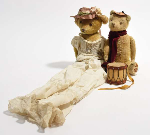 """Two antique teddy bears 12"""" and 14""""H. with dress and hats one with drum (96-33)"""