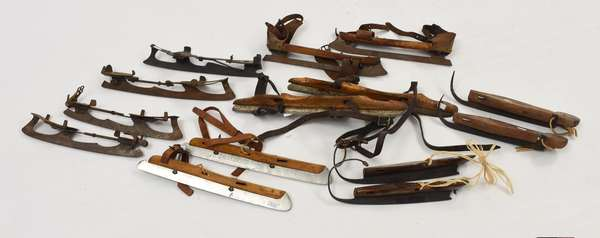 Seven pairs of wooden ice skates (561-34)