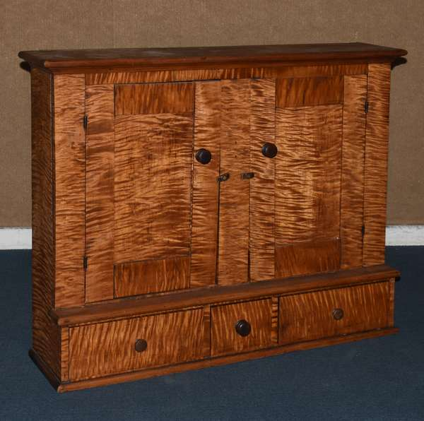 """Tiger maple cabinet with two doors over three drawers, 31""""H. x 38""""W. x 11""""D. (117-2)"""