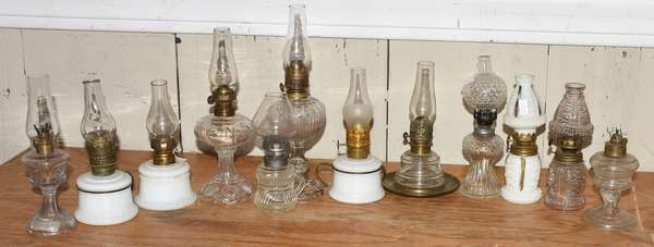 Group of twelve miniature lamps, clear and colored (23-52)