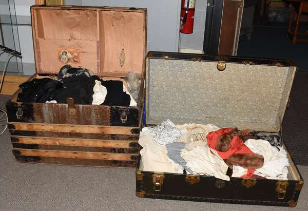 Two antique trunks filled with antique clothing, including corsets, furs, etc. (23-212)