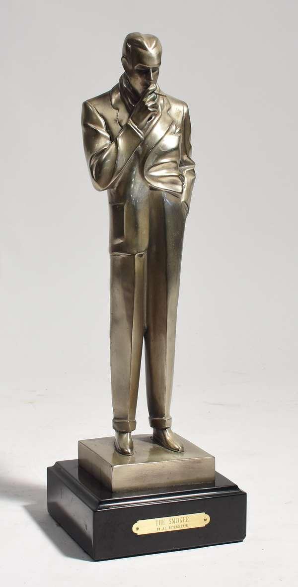 "Art Deco silver bronze sculpture by J.C. Leyendecker, ""The Smoker,"" on a black marble base, 16.5""H"