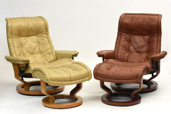 """Two vintage leather reclining lounge chairs with ottomans, one in cream, other light brown, 34""""W. x 39""""H."""