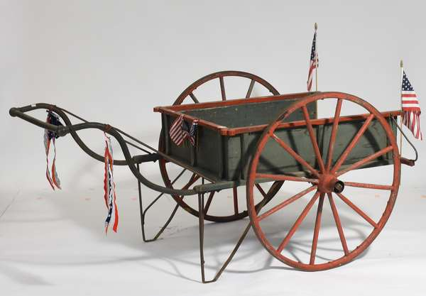 """Charming antique blue and red painted two wheel flower cart, with iron handle, 68""""L. x 32""""H."""
