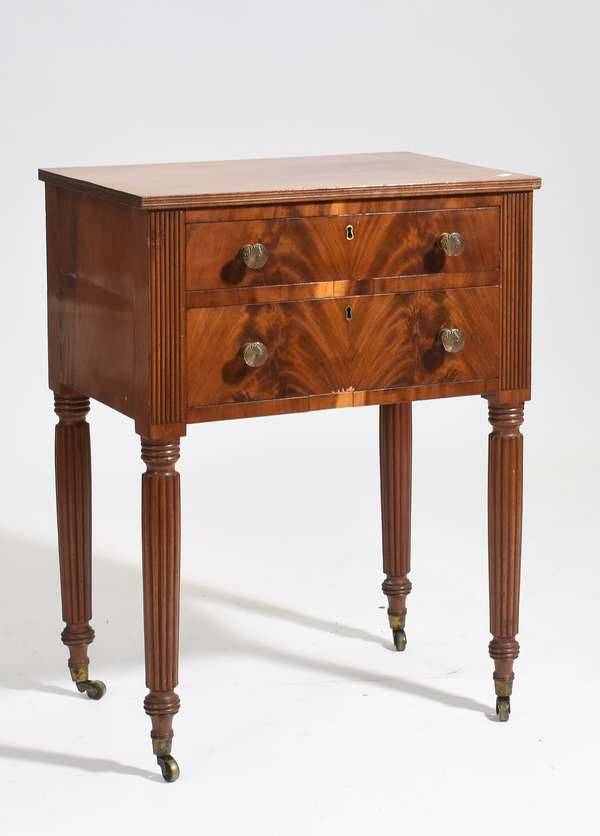 """Early 19th C. Sheraton mahogany two drawer reeded leg stand, with book match veneer drawer fronts, 22""""L. x 15.5""""W. x 29.5""""H."""