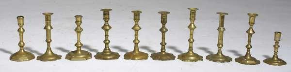 Group of ten 18th C. Queen Anne brass candlesticks