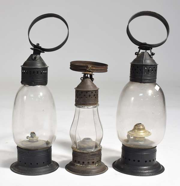 """Three oil lanterns, two large size with early glass globes and large ring handles, 14""""H., with a smaller lantern with 10 sided glass globe, 11""""H."""