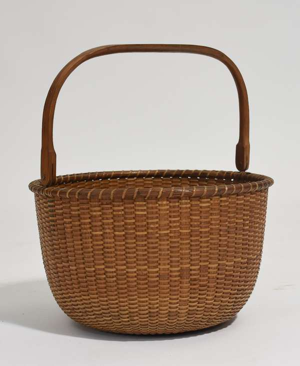 """Large size Nantucket basket with label S.P. Boyer on bottom, with playful inscription, """"I was made on Nantucket Island, I am strong and stout, don't lose or burn me, I'll never wear out"""", 11.5""""Dia. x 7.5""""H."""