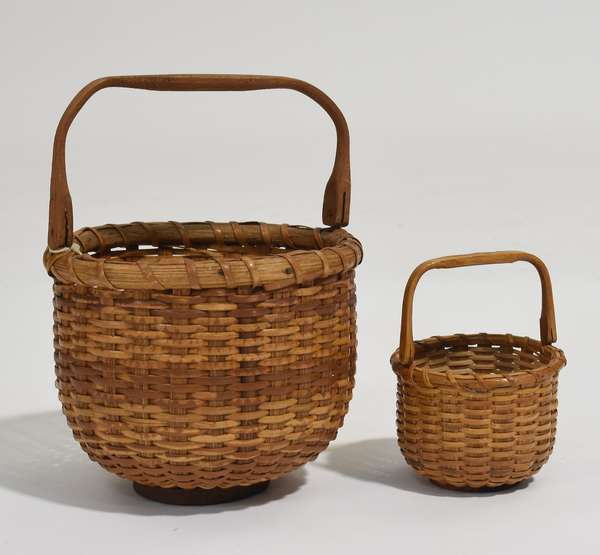 """Two small size Nantucket baskets, including one rare miniature nesting basket, with label of Michael Ray, Starbucks Court, Nantucket Island, 6""""Dia. x 4.5""""H. and 3""""Dia. x 2.25""""H."""