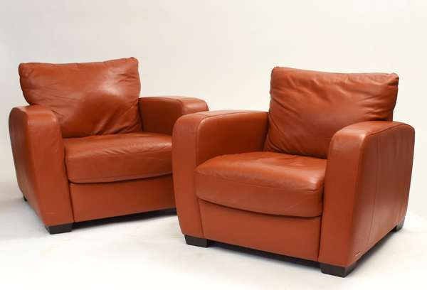 """Pair of Natuzzi designer leather club chairs, light reddish brown colored, 38""""W. x 32""""H."""