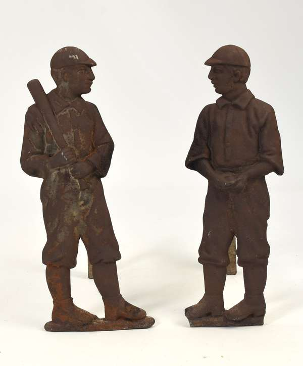 """Pair of late 19th C. cast iron andirons, baseball players, 19.5""""H."""