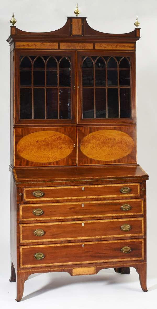"""Important three part Federal Portsmouth NH secretary, mahogany with flame birch inlays including drop panel, attributed to Judkins and Senter Portsmouth NH, ca.1805-1810, 40""""W. 87""""H."""