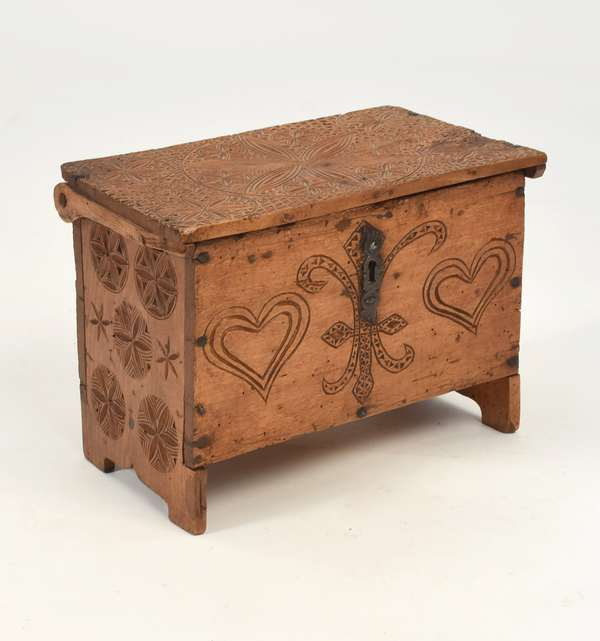 """18th C. carved child's size frisian footed blanket chest, 8.5""""H. x 10.5""""L."""
