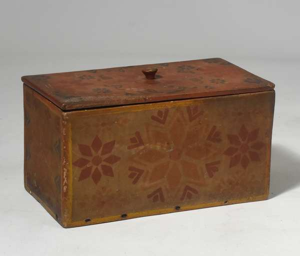"""19th C. stencil paint decorated covered storage box, decorated all around in red, yellow and blue stencil paint, 13""""L. x 7""""H."""