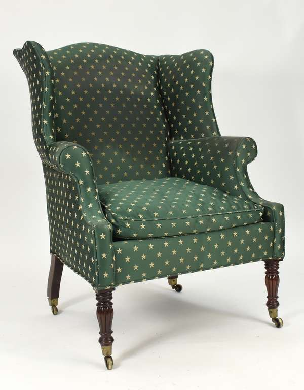 Good Federal carved mahogany wing chair with reeded legs on caster feet, ca.1820
