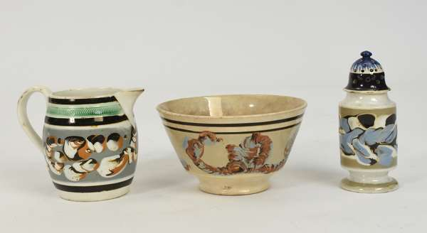 """Three pieces of 19th C. mochaware, including 4""""H. cream pitcher earthworm, 5.25""""H. mottled pepper pot with a 5.5""""D. earthworm bowl"""