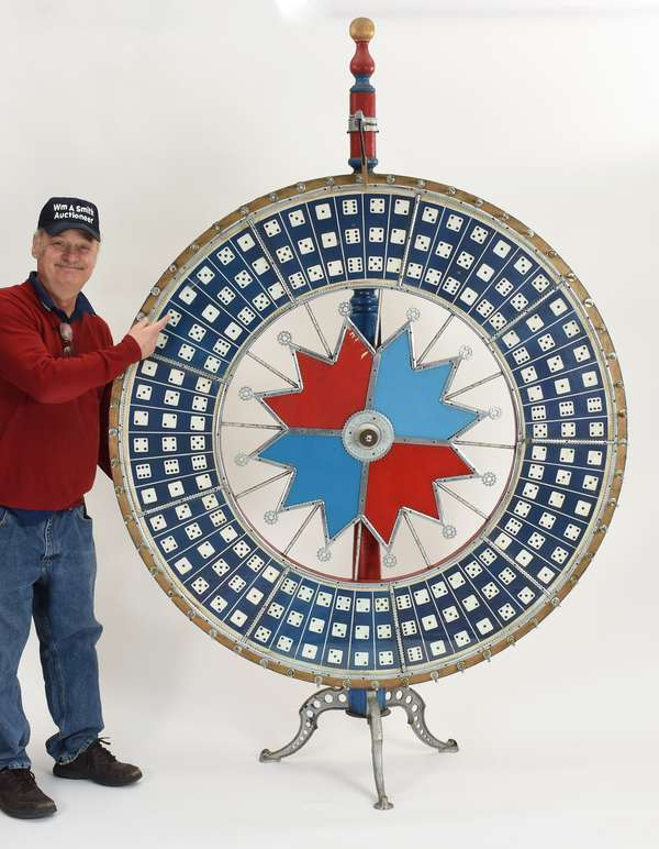 """Large size floor model game wheel, cast iron base, polychrome painted with reverse on glass H C Evans Chicago, 90""""H. x 60""""D. wheel"""