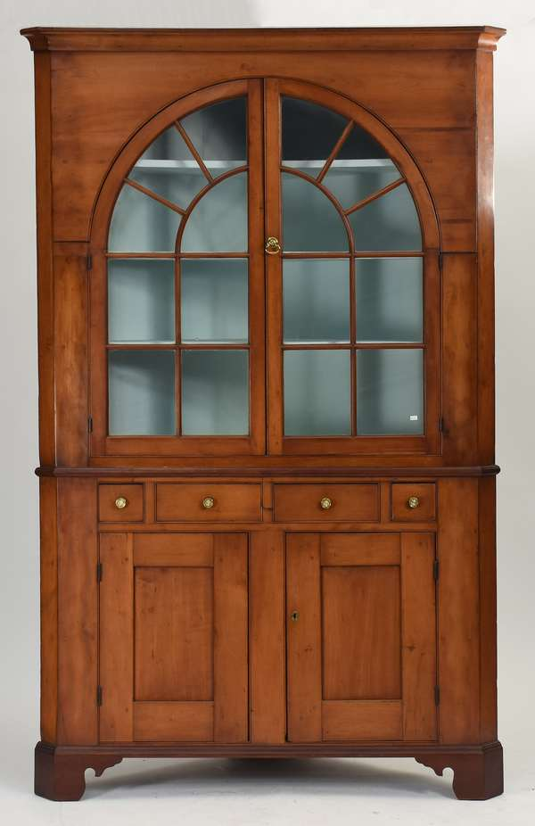"""Federal cherry two-part corner cupboard with arched glass door top and drawers and doors in base, 86""""H. x 54""""W. x 26""""D."""